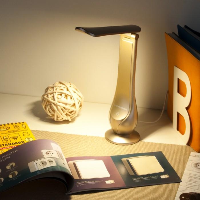 2Настольная лампа TL90420 золотого цвета